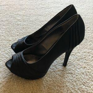 Black open-toed stilettos.